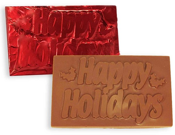 "A 3.5"" wide  Milk chocolate Happy Holidays card wrapped in red foil."
