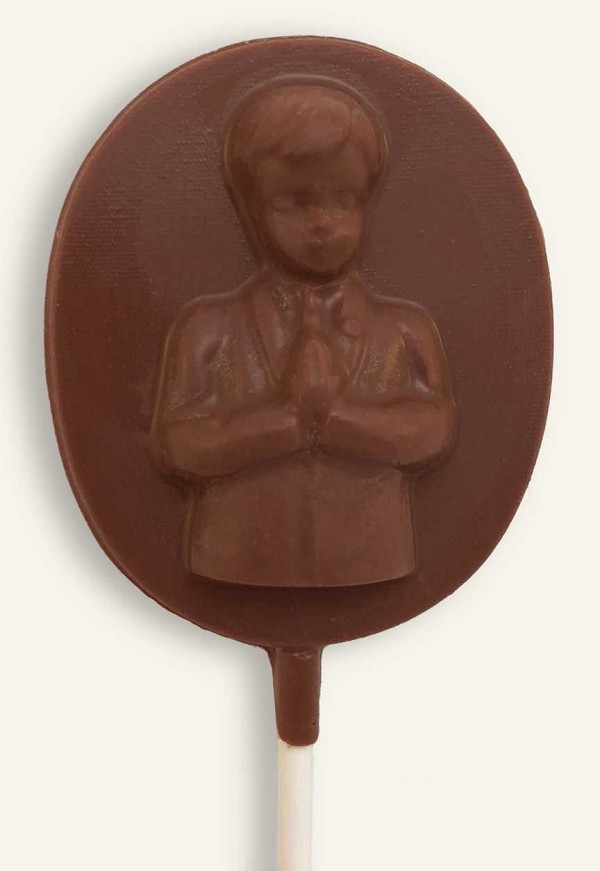 A solid chocolate Communion Boy Pop, wrapped in cellophane and tied with a bow.