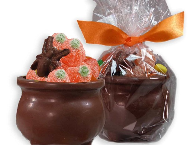 "A 2.5"" chocolate cauldron filled with wonderful Halloween treats including candy corn, creme pumpkins and juju pumpkins. This is all wrapped in cellophane and tied with a ribbon."
