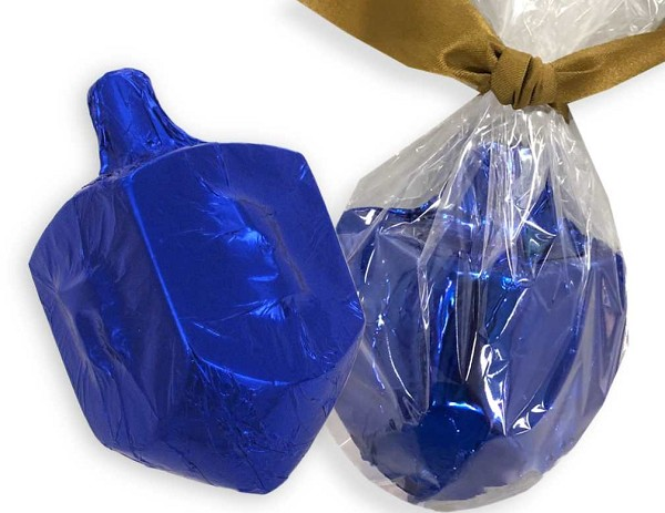 Solid milk chocolate Dreidel, wrapped in blue foil and cellophane and tied with a ribbon.