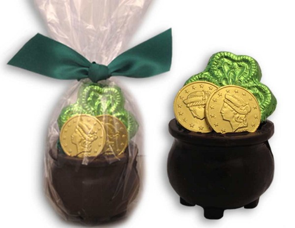 A dark Chocolate Pot filled with Chocolate Gold and a Shamrock.