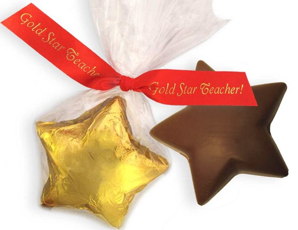 "A solid milk chocolate 3.5 inch star in gold foil wrapped in cellophane and tied with printed ribbon reading ""Gold Star Teacher"".  Net Wt: 1.9 oz."