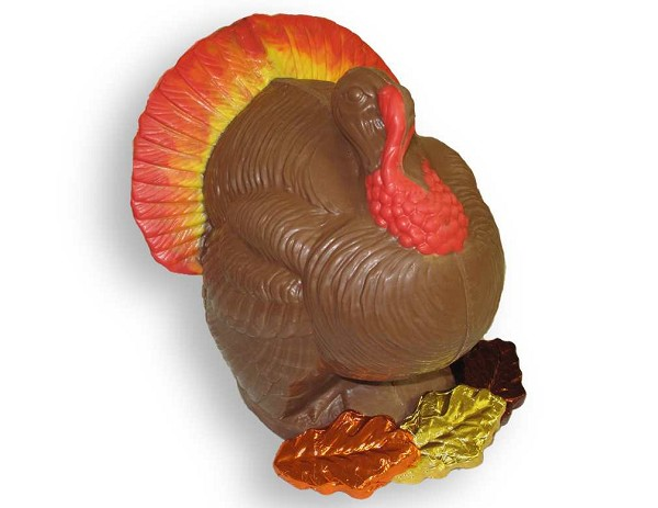 "An 9"" Chocolate Turkey with three foil leaves at his feet. A beautiful centerpiece!"